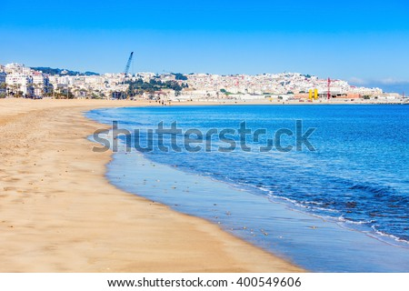 Tangier city beach in Tangier, Morocco. Tangier is a major city in northern Morocco. Tangier located on the North African coast at the western entrance to the Strait of Gibraltar. - stock photo