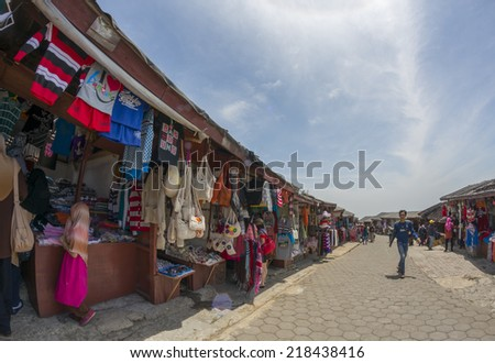 TANGKUBAN PERAHU, BANDUNG, WEST JAVA, INDONESIA - SEPTEMBER 15, 2014: Wide angle view of local people selling souvenir  in Tangkuban Perahu, Indonesia. - stock photo