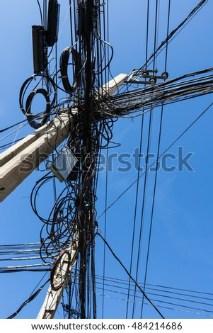 Tangle of electric cable post in thailand