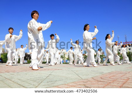 Tangshan - August 8: Chinese Kungfu-Tai Chi exercise in the park, August 8, 2016, tangshan city, hebei province, China