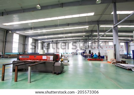 TANGSHAN CITY - MAY 28: Large machinery and equipment in a production workshop, on may 28, 2014, Tangshan city, Hebei Province, China