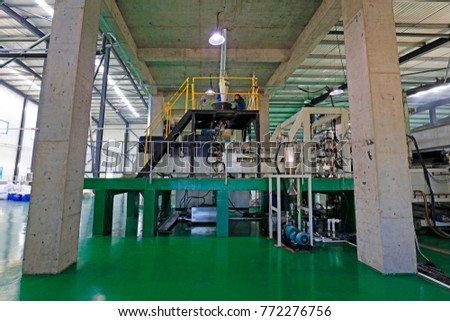 Tangshan City - October 28, 2016: workers busying in the packaging workshop in a factory, Tangshan City, Hebei, China