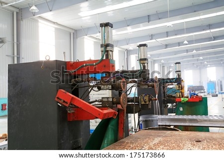 TANGSHAN - DECEMBER 22: The Machinery and equipment in the workshop, in a solar equipment manufacturing enterprises on december 22, 2013, tangshan, china.