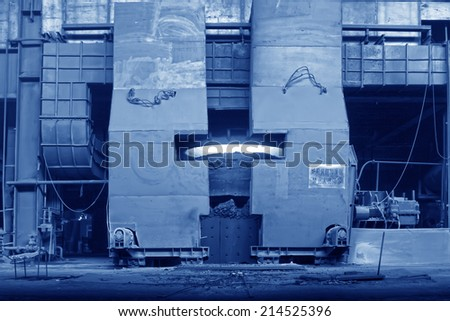 TANGSHAN - JUNE 18: converter gradually open the oven door in a iron and steel co., on June 18, 2014, Tangshan city, Hebei Province, China  - stock photo
