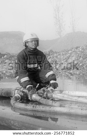 TANGSHAN - NOVEMBER 20: firemen were control remote water supply pipeline in the scene of fire fighting and rescue work, November 20, 2013, tangshan city, hebei province, China.