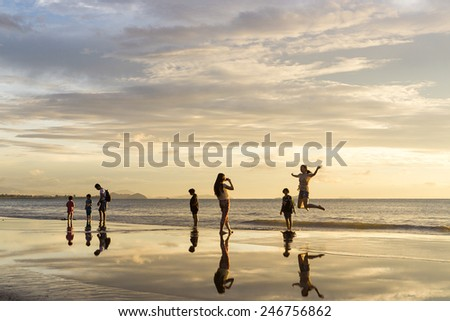 Tanjung Aru, Sabah Malaysia - January 13, 2015: Beach goes enjoying sunset at Tanjung Aru beach.Tanjung Aru beach is listed among ten best place to watch sunset in the world. - stock photo