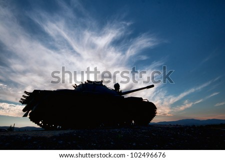 tank silhouette at sunset - stock photo