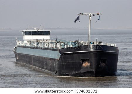 Tanker barge approaching the Port of Antwerp. - stock photo