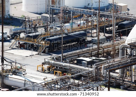 Tanker cars being unloaded at a factory - stock photo