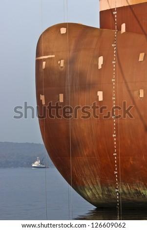 Tanker prove and fishing ship - stock photo