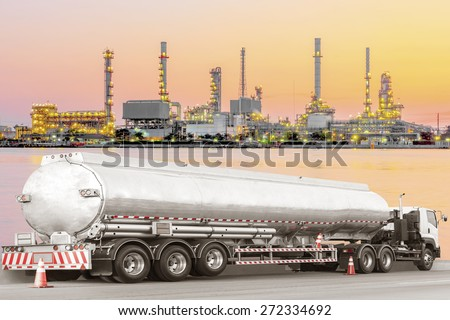 Tanker truck for transport fuel to petrochemical oil refinery in sunrise - stock photo