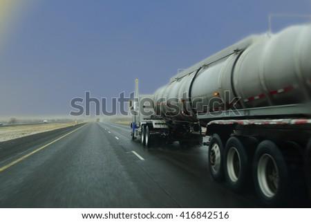 Tanker truck in snowy weather near La Grande, Oregon - stock photo