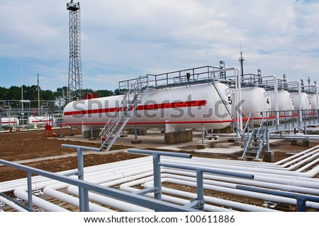 tanks and pipes with gas - stock photo