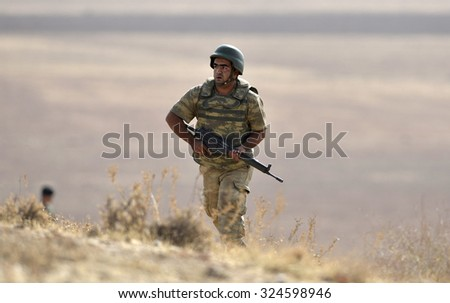 Tanks and soldiers of Turkish military waiting at Turkey - Syria border near source district in Sanliurfa, 27 October 2014, Sanliurfa , Turkey  - stock photo