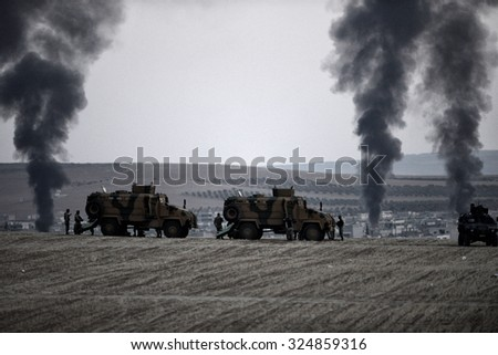 Tanks and soldiers of Turkish military waiting at Turkey - Syria border near source district in Sanliurfa, 26 October 2014, Sanliurfa , Turkey