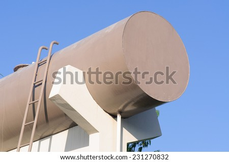 Tanks at water treatment plant - stock photo