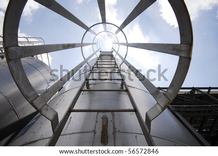 Tanks in an industrial world - stock photo
