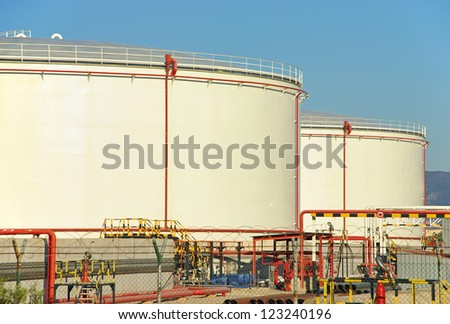 Tanks used to store fuel in an industrial complex - stock photo