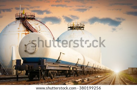 Tanks with gas being transported by rail - stock photo