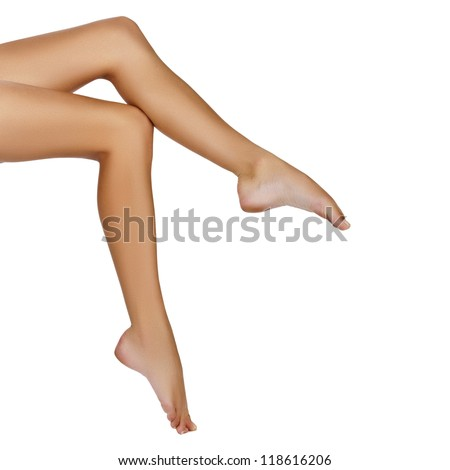 tanned long fit woman legs isolated on white - stock photo