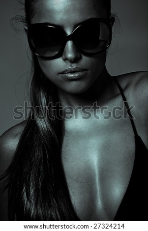 tanned woman portrait with sunglasses - stock photo