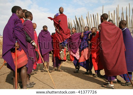 TANZANIA-AUGUST 18: Massai Warriors exhibits her dance before the visit of tourists, their main source of revenue today, August 18, 2007 in Ngorongoro, Tanzania. - stock photo