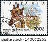 TANZANIA - CIRCA 1993: Stamp printed in Tanzania dedicated to Mikumi National Park, shows giraffe, circa 1993 - stock photo