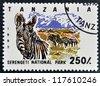 TANZANIA - CIRCA 1993: Stamp printed in Tanzania dedicated to Serengeti national park, shows zebra, circa 1993 - stock photo