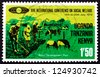 TANZANIA, KENYA, UGANDA - CIRCA 1974: a stamp printed in the Tanzania shows Family Hoeing and Livestock, Social Welfare, circa 1974 - stock photo