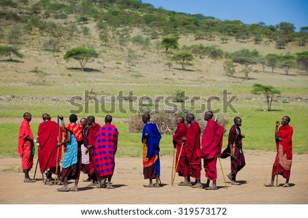 Tanzania .2015  Year january 28 .Masai group in red and blue clothes in beautifully african valley