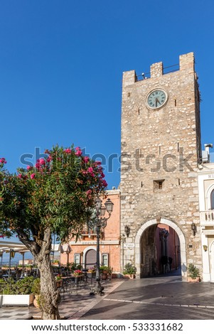 TAORMINA, ITALY - AUGUST 20 2016: Taormina's clock tower originally built in the 12th century, reconstructed in 1679.