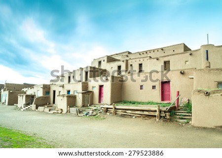 Taos adobe settlement represents the culture of the Pueblo Indians of Arizona and New Mexico, USA - stock photo