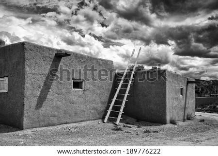 Taos Pueblo in Black and White - stock photo