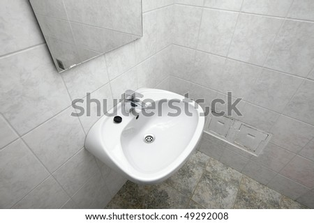 Tap and basin in a bathroom - stock photo