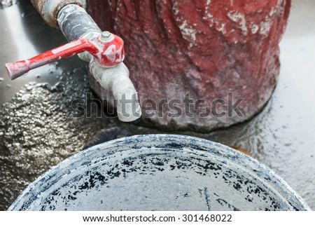 Tap and Mortar Mixing Tub. - stock photo