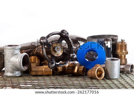 Tap water, pipe couplings, clutches, seal carving on a white background - stock photo