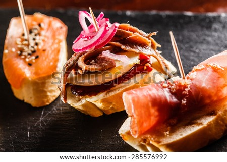 Tapas on Crusty Bread - stock photo