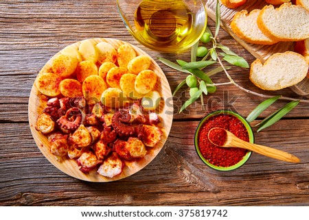 Tapas Pulpo a Feira with octopus potatoes gallega style and paprika recipe from Spain - stock photo