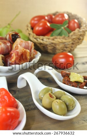 Tapas stuffed with prunes, figs and apricots on wooden plate - stock photo