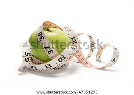 Tape Measure and Apple on White Background