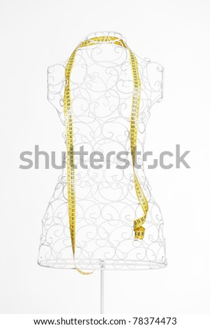 tape measure on a mannequin/metric mannequin - stock photo