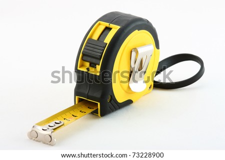 Tape measure on neutral  background - stock photo