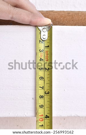 Tape measure on the wall.