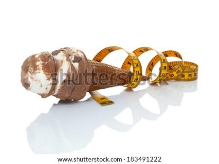 tape measure ribbon around an ice cream cone - stock photo