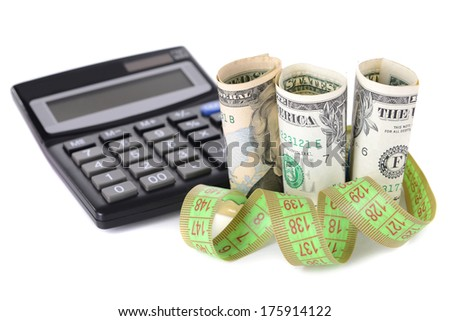 Tape measure with money and calculator isolated on white - stock photo
