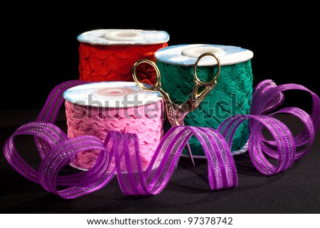 tape with scissors on a dark background - stock photo
