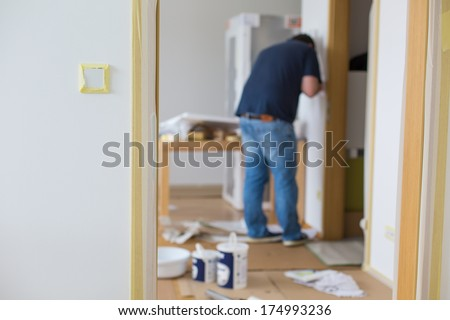Taping switch and home for protection before painting - stock photo