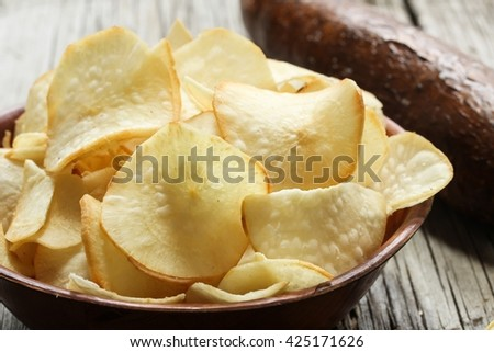Tapioca chips / Yucca Chips with Yucca on side- Popular deep fried Kerala snack with Tapiyoca,selective focus