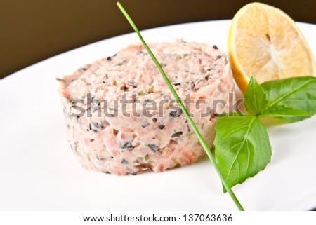 Tar-tar from salmon and tuna with avocado - stock photo