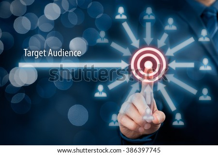 Target audience concept. Businessman click on target, audience pointing to target is around target, bokeh in background.